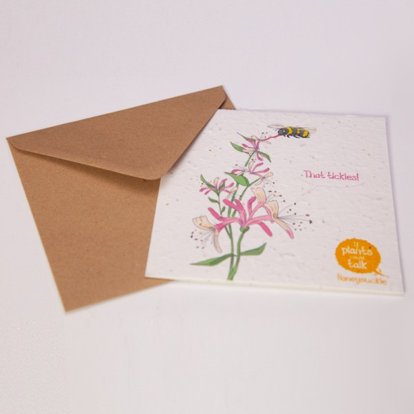 """seed paper greeting card 'if plants could talk' showing a Honeysuckle plant plant being pollinate by a bee, saying """"That tickles!"""""""